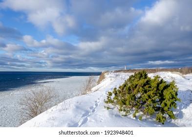 Baltic Sea on wintertime with broken ice cracks. Paldiski cliff in Estonia