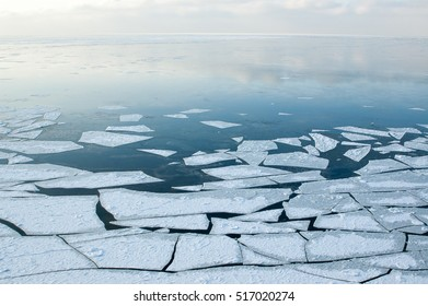 Baltic Sea on wintertime with broken ice cracks. from the top of a cliff top views of the sea in winter