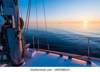 Baltic Sea at sunset. Pure evening sunlight and reflections on the water. View from the yacht. Latvia
