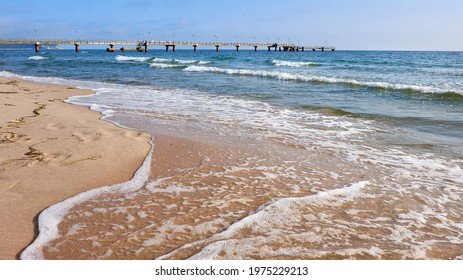Baltic sea, waves and deserted beach on island Rugen in Northern Germany. Romantic seaside.