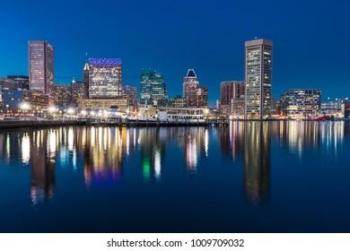 BALTIMARE, MD - DECEMBER 29, 2014: Baltimore night skyline reflection from Inner Harbor