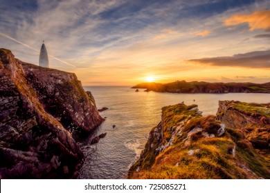 Baltimore Beacon, West Cork, Ireland at sunset on the Wild Atlantic Way.