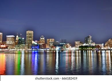 Baltimore inner harbor cityscape at night