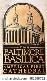 Baltimore, Maryland - July 23, 2013:  Bronze plaque in front of the 1821 Baltimore Basilica,  the first Catholic cathedral built in the USA