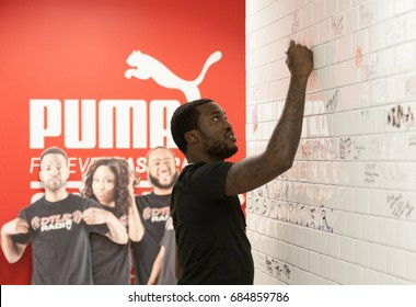 BALTIMORE, MARYLAND - JULY 25, 2017: Meek Mill signs wall at the DTLR Radio Station in Baltimore, Maryland to promote his new album, Wins & Losses, on July 25, 2017.