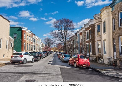 BALTIMORE, MARYLAND - MARCH 3: Colorful row homes in this Hampden neighborhood on March 3 2017 in Northern Baltimore.