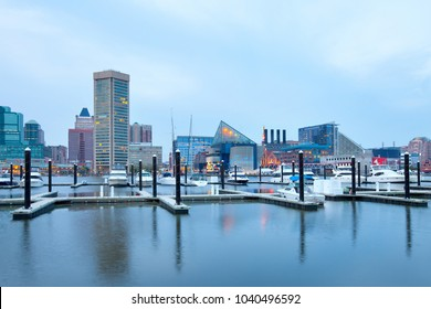Baltimore, Maryland, United States â?? April 25, 2011: Downtown city skyline at the Inner Harbor and Baltimore National Aquarium.
