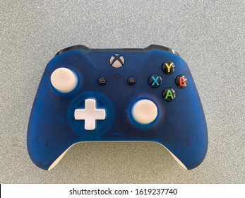 Baltimore, Maryland / US - January 17, 2020: Consumer modified blue Microsoft xbox one wireless controller new faceplate thumb sticks and D pad modded