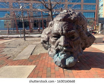 Baltimore, Maryland / US - January 29, 2020: Fredrick Douglass public bronze bust sculpture on the brick waterfront walk way at Fells Point historic between Browns Wharf and broadway pier downtown
