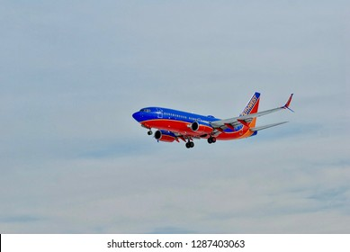 Baltimore, Maryland, USA - January 15, 2019: A Southwest Airlines 737 passenger jet approaches Baltimore/Washington International Thurgood Marshall Airport (BWI) on a cloudy winter day.