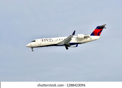 Baltimore, Maryland, USA - January 15, 2019: A Delta Connection Bombardier CRJ-200LR descends to Baltimore/Washington International Thurgood Marshall Airport (BWI) on final approach for landing.