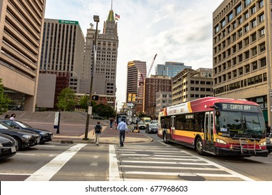 Baltimore, Maryland, USA - July 11, 2017: Traffic and pedestrians in downtown Baltimore near the city center.