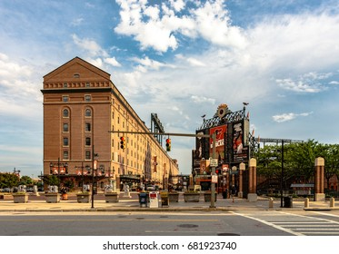 "Baltimore, Maryland, USA - July 11, 2017: A view of Eutaw Street between B&O Warehouse and Oriole Park at Camden Yards. Camden Yards was the first of the ""retro"" style Major League ballparks."