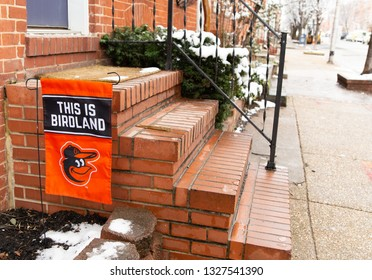 Baltimore, Maryland / USA - March 1 2019: Historic Federal Hill Baltimore Charles Street Winter Streetscape Orioles Sign Rowhouse Brick Stairs