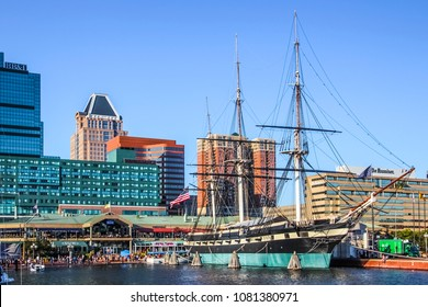 Baltimore, Maryland, USA - November 7, 2011; Baltimore downtown buildings with sailboat during sunny day