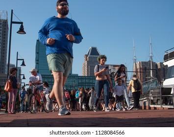Baltimore, Maryland/USA - May 24, 2018: People Gather Along Baltimore Inner Harbor Waterfront Boardwalk
