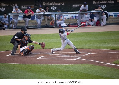 BALTIMORE - MAY 1: Dustin Pedroia of the Boston Red Sox swings at a pitch during a game at Camden Yards on May 1, 2010 in Baltimore, Maryland