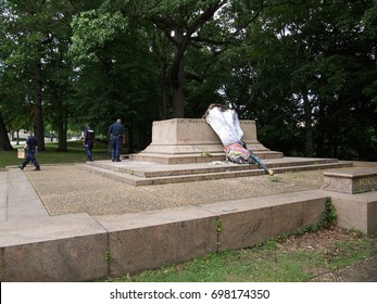 BALTIMORE, MD - AUGUST 17, 2017: A sculpture that occupied a removed confederate monument site was discovered toppled over today. Police and forensics investigators look for signs of vandalism.