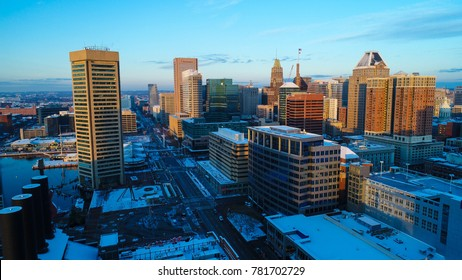 Baltimore, MD - December 16, 2017: An aerial view of Baltimore's Inner Harbor after a night of snow.