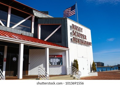 Baltimore, MD - January 27, 2018: Rusty Scupper Restaurant & Bar is a local landmark serving upscale regional seafood dishes in a waterfront setting for over 30 years in the city.