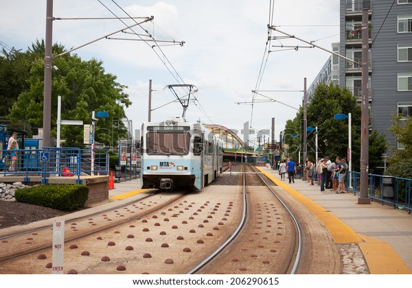 Baltimore, MD - July 19, 2014. Baltimore Light Rail vehicle pulls into a station.