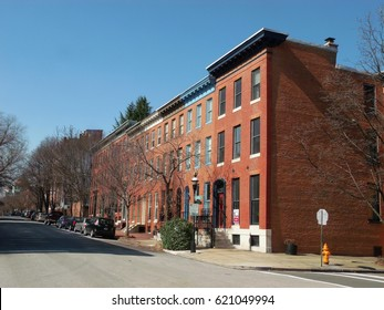 Baltimore, MD:  Midtown neighborhood of Bolton Hill; corner of Park Ave. and Lanvale St.  Three-story rowhouses.  Wide, tree-lined street.