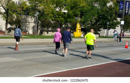 Baltimore, MD / USA  (10-20-2018):   Four individuals participating in Baltimore Running Festival (downtown), heading towards finish line.