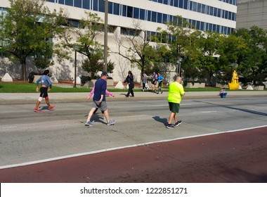 Baltimore, MD / USA  (10-20-2018): Individuals participating in Baltimore Running Festival.  Downtown, near corner of Pratt St. and Hopkins Pl, in front of federal court building.