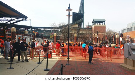 Baltimore, MD - U.S.A. - 3/29/2018.....Orioles fans and others entering Oriole Park on Opening Day for the Baltimore Orioles.