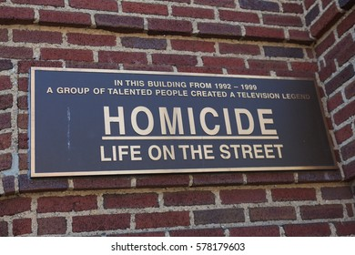 Baltimore, MD, USA - July 26, 2011: A sign on the Recreation Pier at Fells Point in Baltimore commemorates the building had been featured as police headquarters for NBCs  Homicide: Life on the Street.