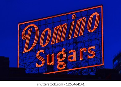 Baltimore, MD, USA June 25, 2014 A neon Domino Sugar sign glows against the dusk sky in Baltimore Maryland