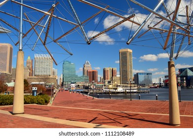 Baltimore, MD, USA March 26, 2014 The Baltimore skyline rises from under an art installation at the Baltimore Museum of Science at the southern end of Inner Harbor