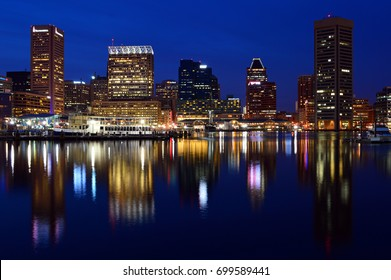Baltimore, MD, USA March 28 The skyline of Baltimore Maryland is reflected in the waters of Inner Harbor