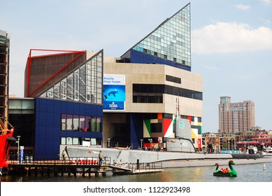 Baltimore, MD, USA May 10, 2013 The stark geometric lines of the National Aquarium in Baltimore stand out in the Inner Harbor area