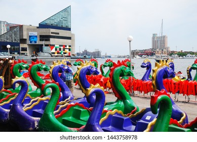 Baltimore, MD, USA May 10, 2013 Dragon pedal boats are available to rent  in the Inner Harbor area of Baltimore, Maryland