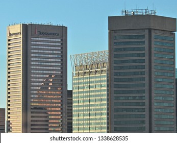 Baltimore, Md./USA-Oct. 17, 2017: The downtown headquarters of Transamerica Corp., left, stands next to the T. Rowe Price and Maryland World Trade Center buildings.