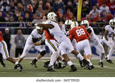 BALTIMORE - OCTOBER 24: Maryland Terrapins quarterback Perry Hills (11) fumbles as he is sacked during the NCAA football game against PSU October 24, 2015 in Baltimore.