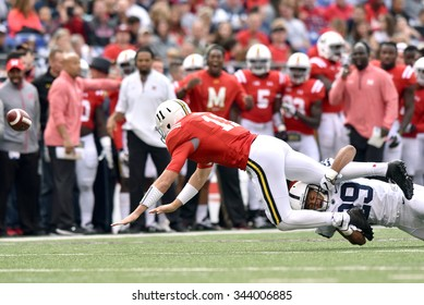 BALTIMORE - OCTOBER 24: Maryland Terrapins quarterback Perry Hills (11) loses control of the ball as he is tackled during the NCAA football game against Maryland October 24, 2015 in Baltimore.