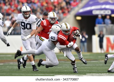 BALTIMORE - OCTOBER 24: Penn State Nittany Lions linebacker Jason Cabinda (40) makes a tackle on a rushing play during the NCAA football game against Maryland October 24, 2015 in Baltimore.