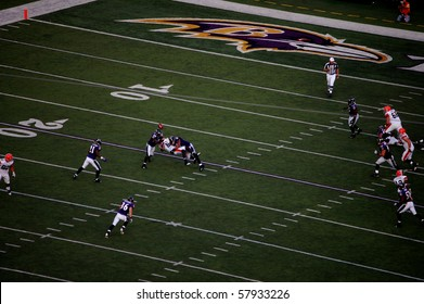 BALTIMORE - SEPTEMBER 21: Kellen Winslow Jr. of the Cleveland Browns can not hold on to the ball as he is tackled by two players from the Baltimore Ravens September 21, 2008 in Baltimore, MD