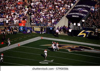 BALTIMORE - SEPTEMBER 21: Players from the Cleveland Browns and Baltimore Ravens jump for a Hail Mary pass at the end of the half at M&T Bank Stadium September 21, 2008 in Baltimore, MD