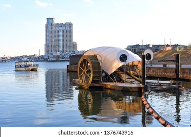 Baltimore, United States of America- March, 5, 2019: The inner harbor water wheel.
