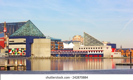 BALTIMORE, USA - JANUARY 31, 2014: National Aquarium buildings at Inner Harbor pier on January 31, 2014 in Baltimore, USA. Colorful reflections of buildings in ice on a sunny winter day.