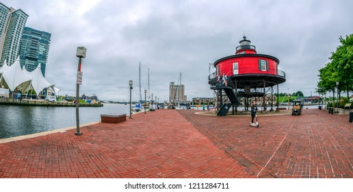 BALTIMORE, USA - SEPTEMBER 8, 2018: The Waterfront Promenade at the Inner Harbor with the Seven Foot Knoll Lighthouse, first lit in 1856 and the oldest screwpile lighthouse in Maryland.