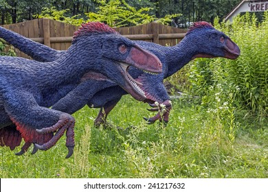 Baltow, Poland - June 12, 2014: Realistic model of feathered dinosaurs in Jura Park, Baltow on June 12, 2014. Jura Park in Baltow exihibits numerous natural size dinosaurs models.