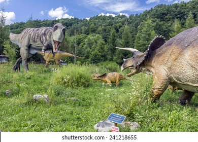 Baltow, Poland - June 12, 2014: Realistic model of Tyrannosaurus rex vs. Triceratops family in Jura Park, Baltow on June 12, 2014. Jura Park in Baltow exihibits numerous natural size dinosaurs models.