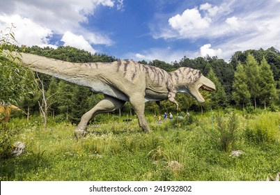 Baltow, Poland - June 12, 2014: Realistic model of tyrannosaurus rex running in Jura Park, Baltow on June 12, 2014. Jura Park in Baltow exihibits numerous natural size dinosaurs models.
