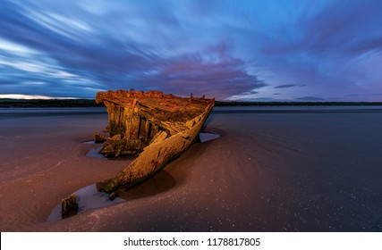Baltray shipwrack, Shipwrecked off the coast of Ireland, An shipwreck or abandoned shipwreck,,boat Wreck Sunset light at the beach, Wrecked boat abandoned stand on beach or Shipwrecked off the coast