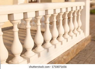 balusters made of natural material, column, frame for stairs, Palace style. The concept of using natural materials in construction, design and architecture.