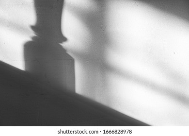 Balustrade shadow on white wall background texture